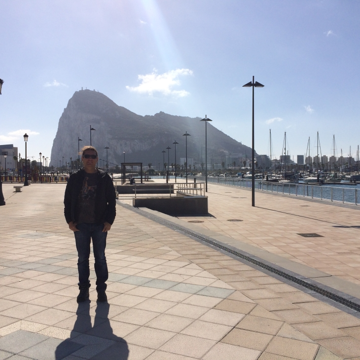 Me just outside the border of Gibraltar, with the Rock in the background