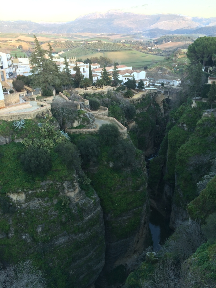 Looking back at the town and all the houses perched on the edge of the chasm