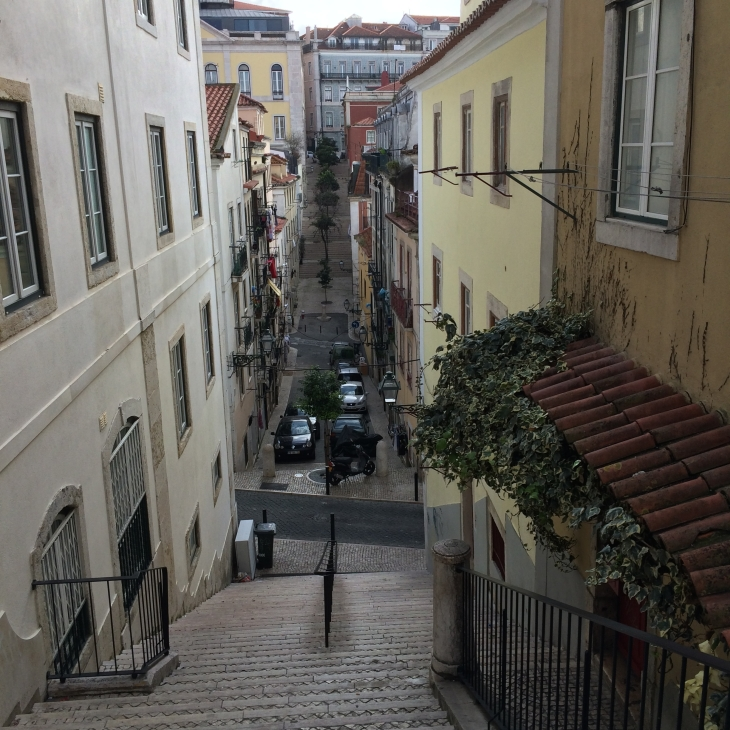 A typical street in Lisbon, complete with washing hanging from the balconies